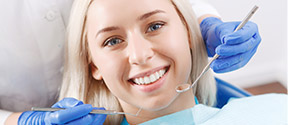 blonde woman receiving dental care