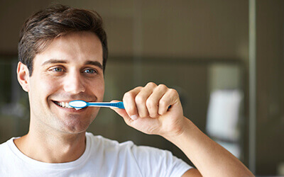 Allentown Preventive Dentistry Man brushing his teeth