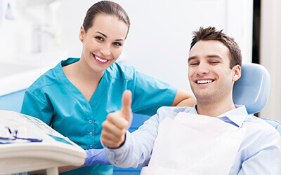 Man with dentist giving thumbs up