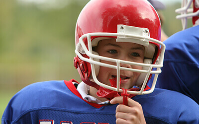 Boy in football gear