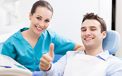 male patient giving thumbs up